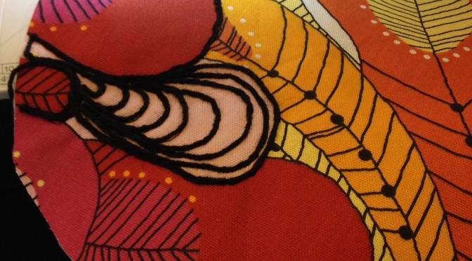 Dekorere stoff med garn